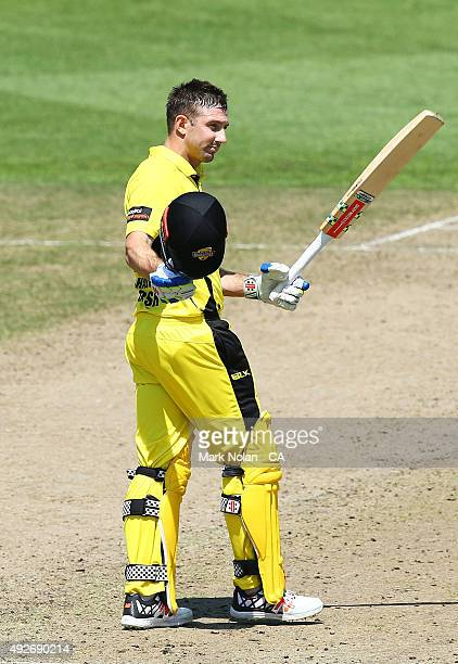 Shaun Marsh of the Warriors celebrates his century during the Matador BBQs One Day Cup match between Western Australia and Cricket Australia XI at...