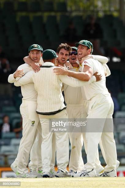 Shaun Marsh Usman Khawaja Pat Cummins Cameron Bancroft and Mitchell Marsh of Australia celebrate the wicket of Chris Woakes of England and reclaiming...