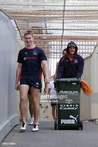 Shaun McKernan and Taylor Walker walks out before taking part in an Adelaide Crows AFL training session at AAMI Stadium on March 21 2013 in Adelaide...