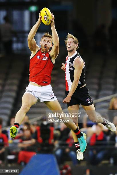 Shaun McKernan of Essendon marks the ball against Jimmy Webster of the Saints during the AFLX match between Essendon Bombers and StKilda Saints at...