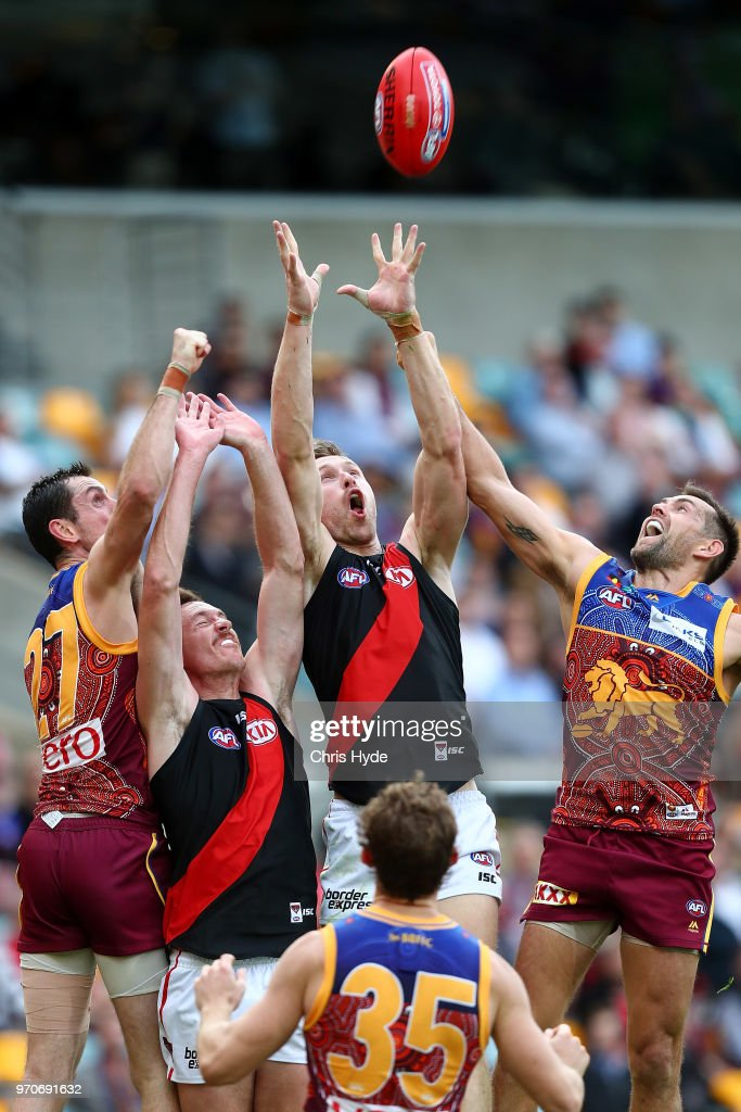Shaun McKernan of the Bombers and Luke Hodge of the Lions compete for the ball during the round 12 AFL match between the Brisbane Lions and the Essendon Bombers at The Gabba on June 10, 2018 in Brisbane, Australia.