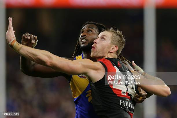 Shaun McKernan of the Bombers contests a ruck with Nic Naitanui of the Eagles during the round 14 AFL match between the West Coast Eagles and the...