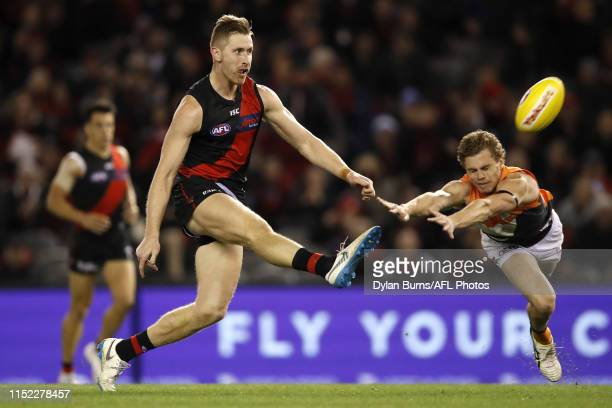 Shaun McKernan of the Bombers kicks a goal during the 2019 AFL round 15 match between the Essendon Bombers and the GWS Giants at Marvel Stadium on...