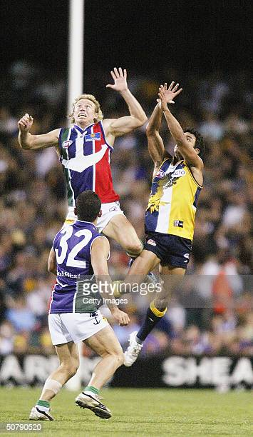Shaun McManus of the Dockers in action against Daniel Kerr of the Eagles during the round six AFL match between the West Coast Eagles and Fremantle...