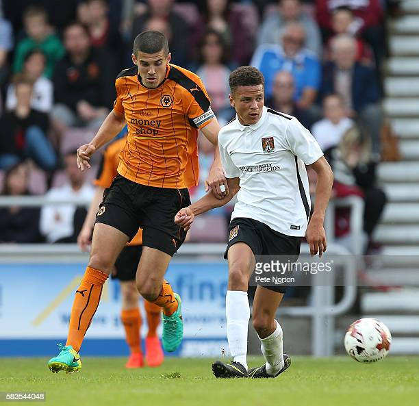 Shaun McWillims of Northampton Town plays the ball away from Conor Coady of Wolverhampton Wanderers during the PreSeason Friendly match between...