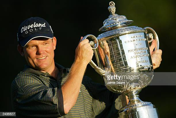Shaun Micheel of the USA holds the trophy after winning the 85th PGA Championship at Oak Hill Country Club on August 17 2003 in Rochester New York