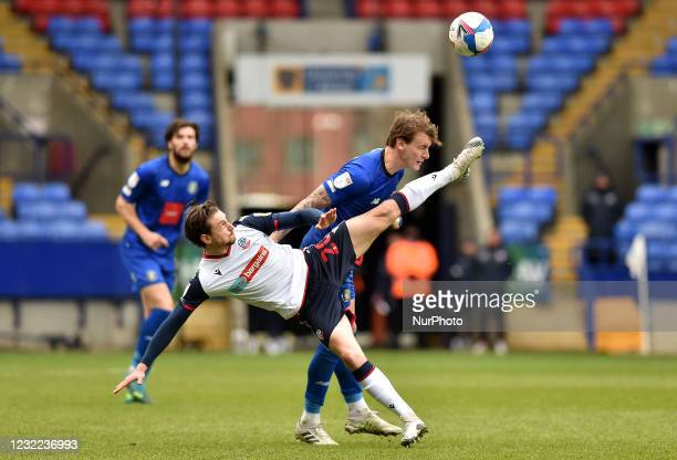 Shaun Miller of Bolton Wanderers tussles with Will Smith of Harrogate Town during the Sky Bet League 2 match between Bolton Wanderers and Harrogate...