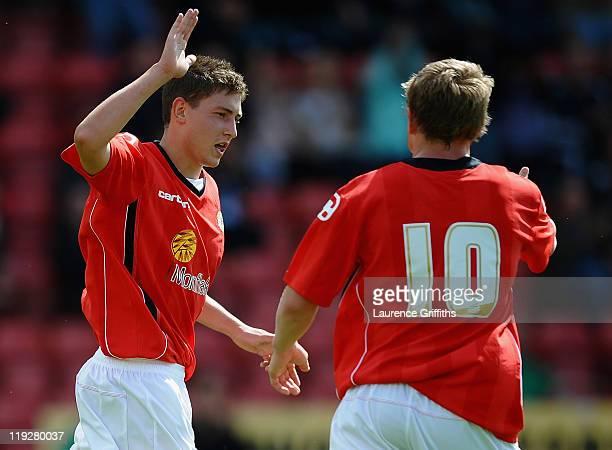 Shaun Miller of Crewe celebrates scoring the opening goal during the Pre Season Friendly match between Crewe Alexandra and Wolverhampton Wanderers at...