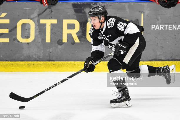 Shaun Miller of the BlainvilleBoisbriand Armada skates the puck against the BaieComeau Drakkar during the QMJHL game at Centre d'Excellence Sports...