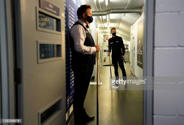 Shaun Murphy and Judd Trump of England wait to walk out during day 11 of the Betfred World Snooker Championships 2021 at the Crucible Theatre on...