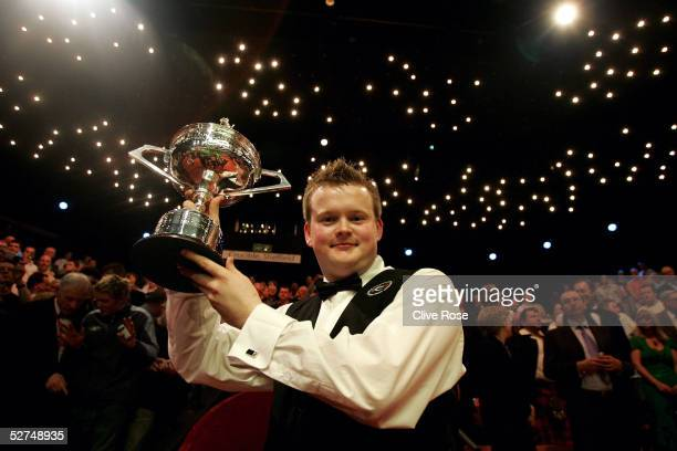 Shaun Murphy holds the trophy after winning the Embassy World Snooker Final against Matthew Stevens at the Crucible Theatre on May 2, 2005 in...