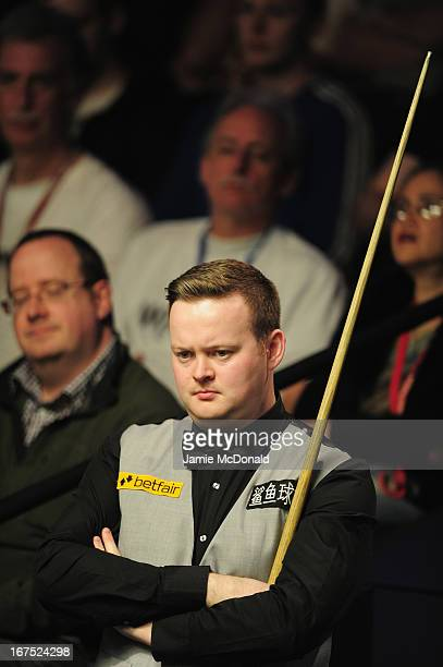 Shaun Murphy looks on during his second round match against Graeme Dott during the Betfair World Snooker Championship at the Crucible Theatre on...