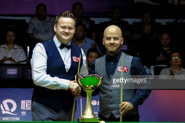 Shaun Murphy of England and Luca Brecel of Belgium shake hands prior to their final match on day seven of Evergrande 2017 World Snooker China...