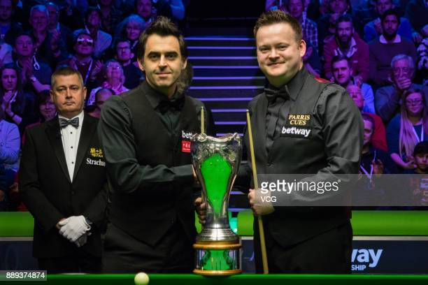 Shaun Murphy of England and Ronnie O'Sullivan of England pose with the trophy before the final match of 2017 Betway UK Championship at Barbican...