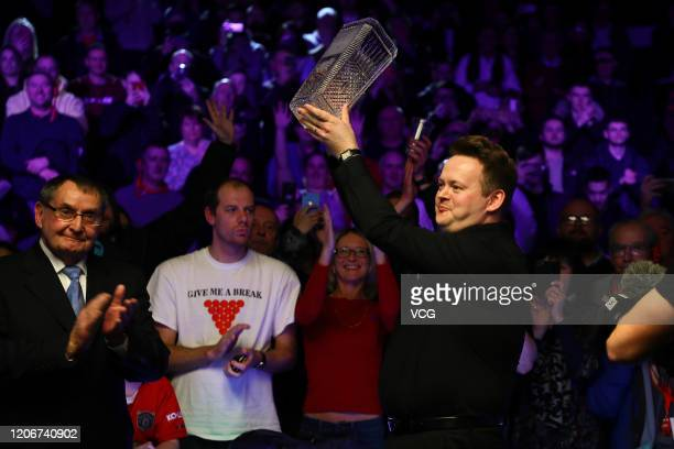 Shaun Murphy of England celebrates with his trophy after winning the final match against Kyren Wilson of England on day seven of the 2020 ManBetX...