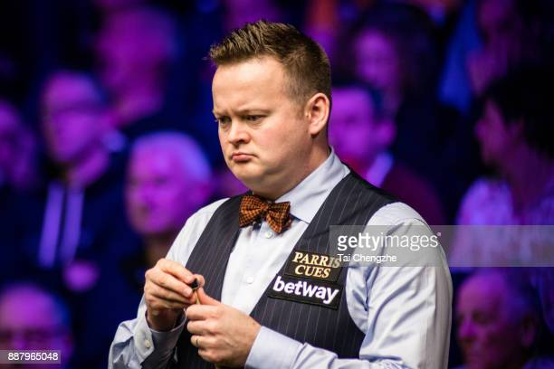 Shaun Murphy of England chalks the cue during his eighthfinal round match against Ricky Walden of England on day 11 of 2017 Betway UK Championship at...