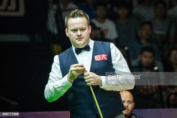 Shaun Murphy of England chalks the cue during his final match against Luca Brecel of Belgium on day seven of Evergrande 2017 World Snooker China...