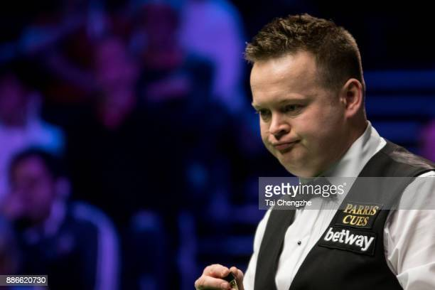 Shaun Murphy of England chalks the cue during his third round match against Jimmy Robertson of England on day 9 of 2017 Betway UK Championship at...