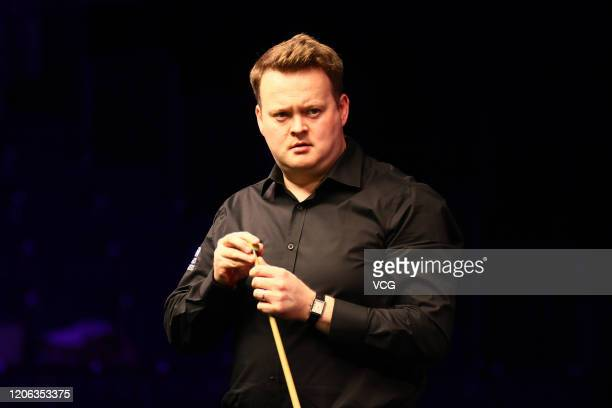 Shaun Murphy of England chalks the cue during the quarter-final match against Judd Trump of England on day five of the 2020 ManBetX Welsh Open at the...