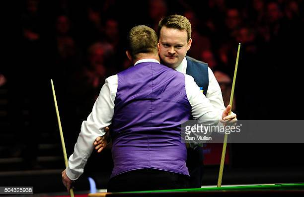 Shaun Murphy of England embraces Mark Allen of Northern Ireland after defeat during Day One of the Dafabet Masters at Alexandra Palace on January 10...