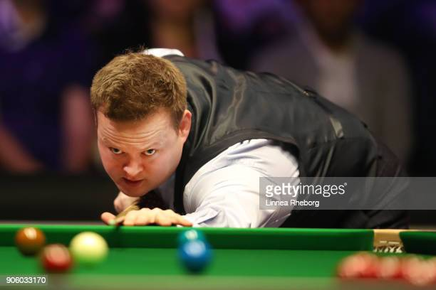 Shaun Murphy of England in action during his first round match against Ali Carter of England on day four of The Dafabet Masters at Alexandra Palace...