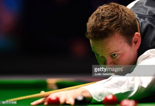 Shaun Murphy of England in action during his match against Judd Trump of England during The Dafabet Masters on Day Six at Alexandra Palace on January...