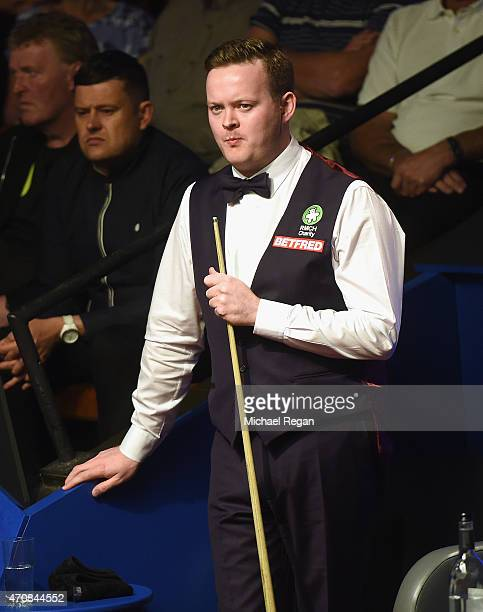 Shaun Murphy of England looks on against Robin Hull of Finland during day six of the 2015 Betfred World Snooker Championship at Crucible Theatre on...