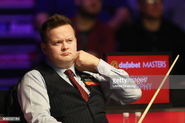 Shaun Murphy of England looks on during his first round match against Ali Carter of England on day four of The Dafabet Masters at Alexandra Palace on...