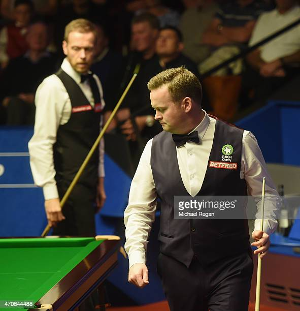 Shaun Murphy of England looks on with Robin Hull of Finland during day six of the 2015 Betfred World Snooker Championship at Crucible Theatre on...