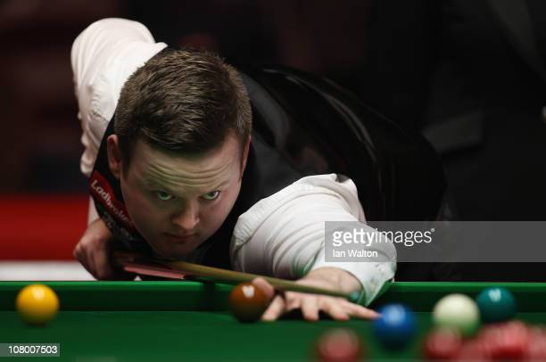 Shaun Murphy of England plays a shot against Jamie Cope of England in Round One of The Ladbrokesmobile Masters on Day 4 at Wembley Arena on January...