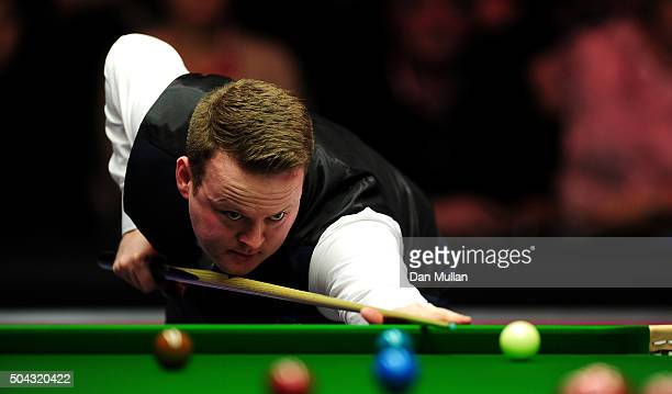 Shaun Murphy of England plays a shot against Mark Allen of Northern Ireland during Day One of the Dafabet Masters at Alexandra Palace on January 10,...
