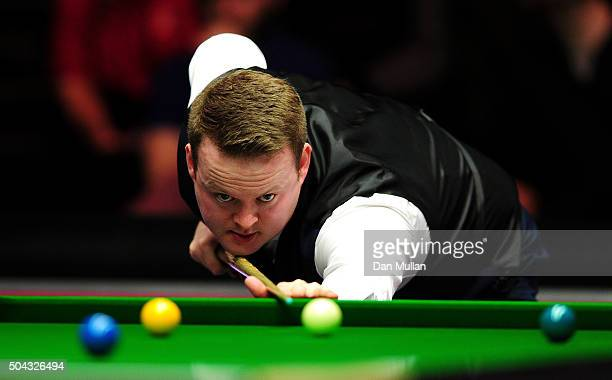 Shaun Murphy of England plays a shot against Mark Allen of Northern Ireland during Day One of the Dafabet Masters at Alexandra Palace on January 10...