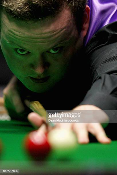 Shaun Murphy of England plays a shot against Neil Robertson of Australia during The Final on day 8 of The Masters at Alexandra Palace on January 22...