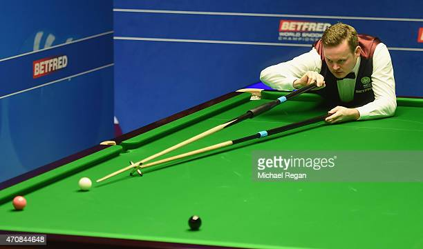 Shaun Murphy of England plays a shot against Robin Hull of Finland during day six of the 2015 Betfred World Snooker Championship at Crucible Theatre...