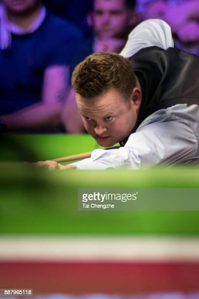 Shaun Murphy of England plays a shot during his eighthfinal round match against Ricky Walden of England on day 11 of 2017 Betway UK Championship at...