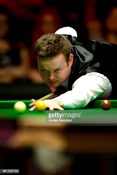Shaun Murphy of England plays a shot during his first round match against Mark Selby of England on day one of the 2015 Dafabet Masters at Alexandra...