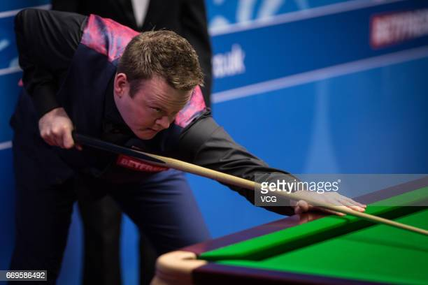 Shaun Murphy of England plays a shot during his first round match against Yan Bingtao of China on day three of Betfred World Championship 2017 at...