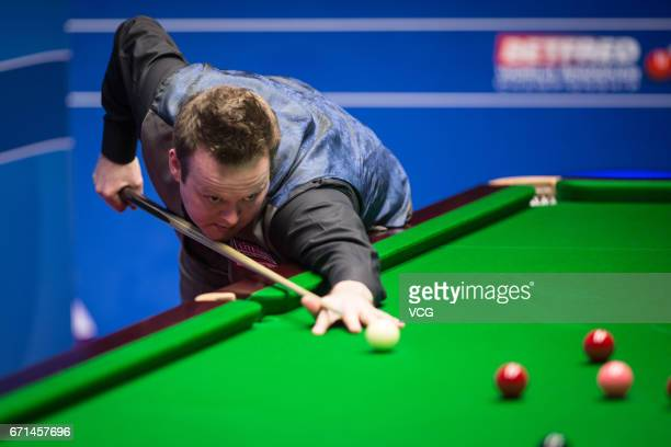 Shaun Murphy of England plays a shot during his second round match against Ronnie O'Sullivan of England on day eight of Betfred World Championship...