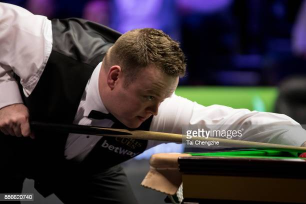 Shaun Murphy of England plays a shot during his third round match against Jimmy Robertson of England on day 9 of 2017 Betway UK Championship at...