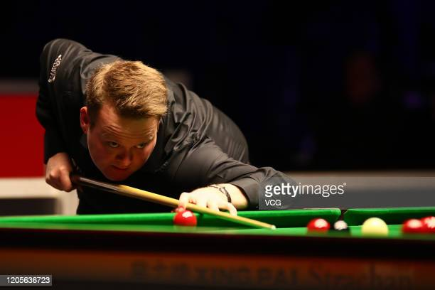 Shaun Murphy of England plays a shot during the 1st round match against Darren Morgan of Wales on day two of the 2020 ManBetX Welsh Open at the...
