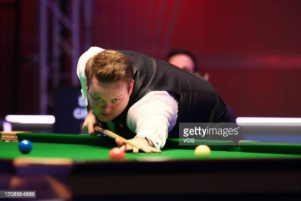 Shaun Murphy of England plays a shot during the 1st round match against David Gilbert of England on day three of 2020 Coral Players Championship at...