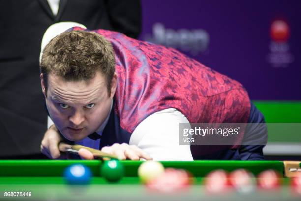 Shaun Murphy of England plays a shot during the first round match against Mei Xiwen of China on Day two of the 2017 Snooker International...