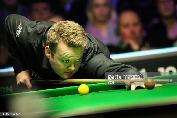 Shaun Murphy of England plays a shot during the quarter-final match against Ronnie O'Sullivan of England on day five of 2019 Northern Ireland Open at...