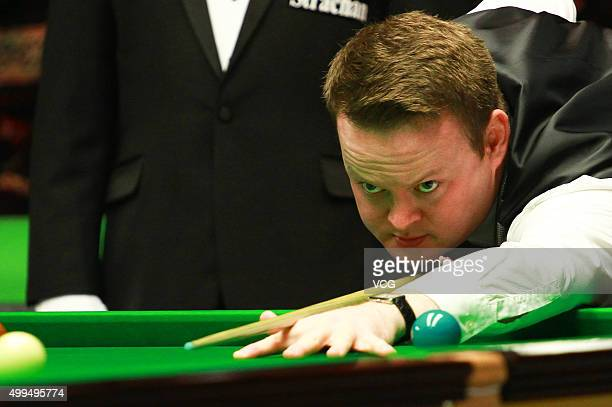 Shaun Murphy of England plays a shot in his match against Ben Woollaston of England on day seven of Betway UK Championship at Barbican Centre on...