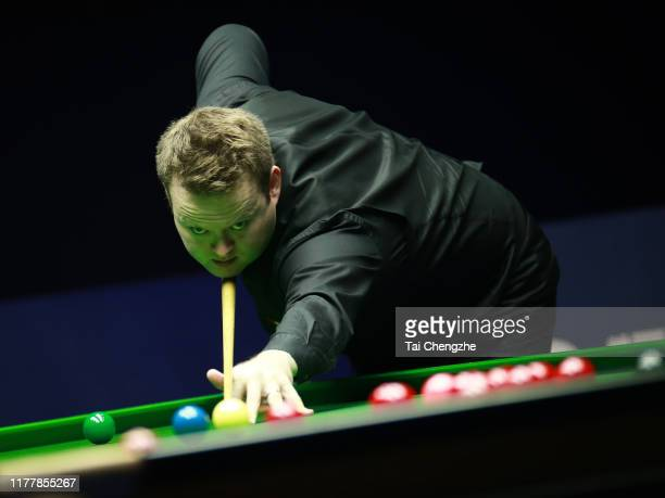 Shaun Murphy of England plays a shot in the final match against Mark Williams of Wales on Day seven of Evergrande 2019 World Snooker China...