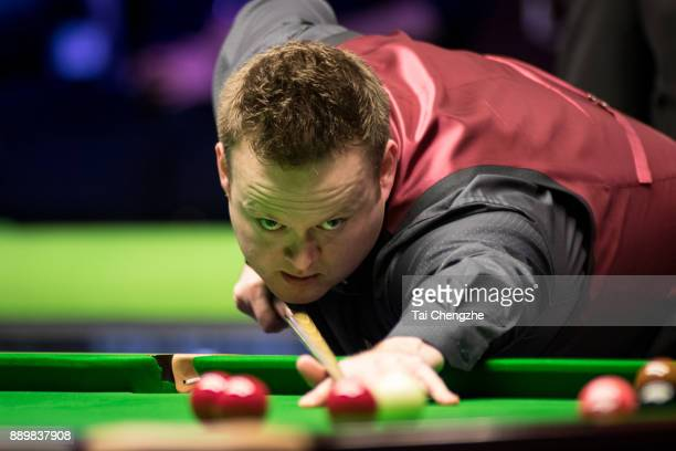 Shaun Murphy of England plays a shot in the final match against Ronnie O'Sullivan of England during the 2017 Betway UK Championship at Barbican...
