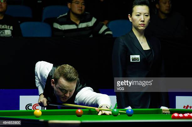 Shaun Murphy of England plays a shot in the match against John Higgins of Scotland on day 4 of Snooker International Championship 2015 at Baihu Media...