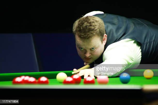 Shaun Murphy of England plays a shot in the quarter-final match against Kurt Maflin of Norway on Day five of Evergrande 2019 World Snooker China...