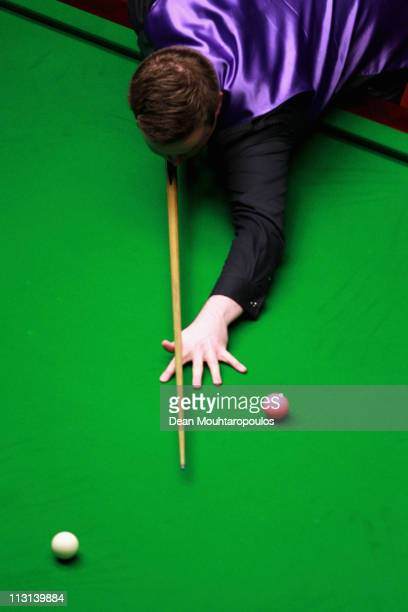 Shaun Murphy of England plays a shot in the round two game against Ronnie O'Sullivan of England during day nine of the Betfredcom World Snooker...