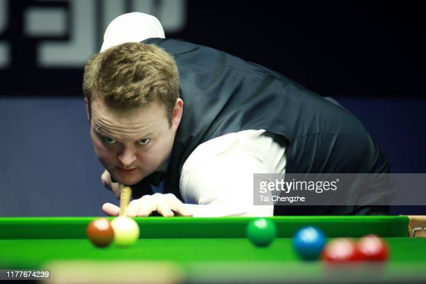 Shaun Murphy of England plays a shot in the semi-final match against Mark Selby of England on Day six of Evergrande 2019 World Snooker China...